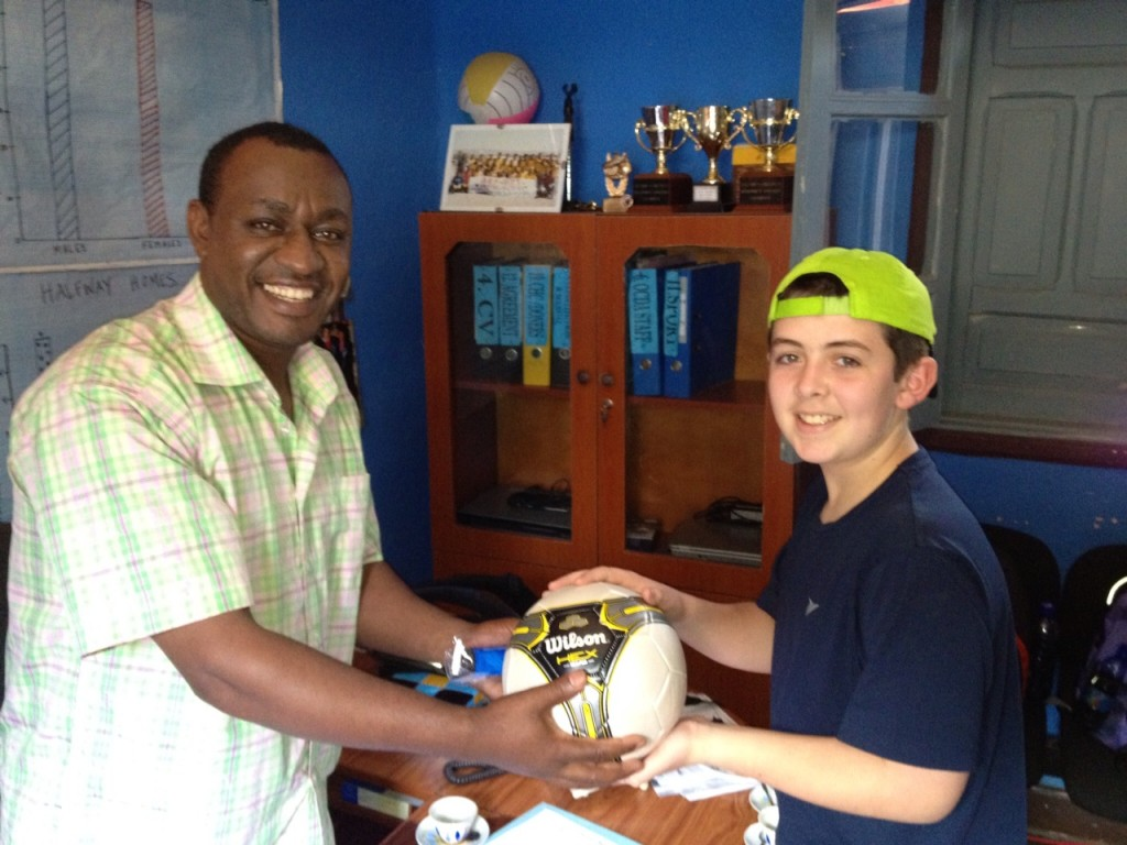 My Grandson, Will, Presenting a Soccer Ball to Nega
