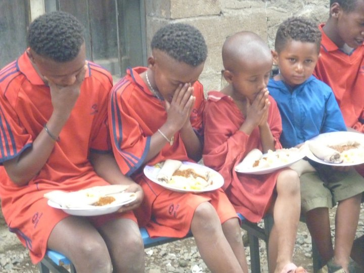 Street Children In Addis Ababa Onesimus House Praying Over Lunch