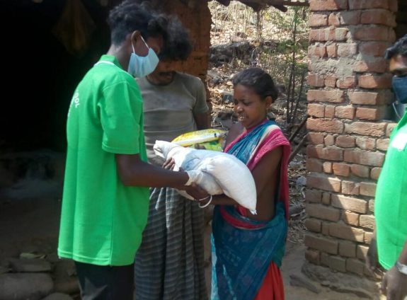 woman receives food rations