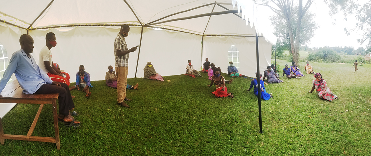 temporary tent provides some shade for patients waiting at the village medical center in uganda
